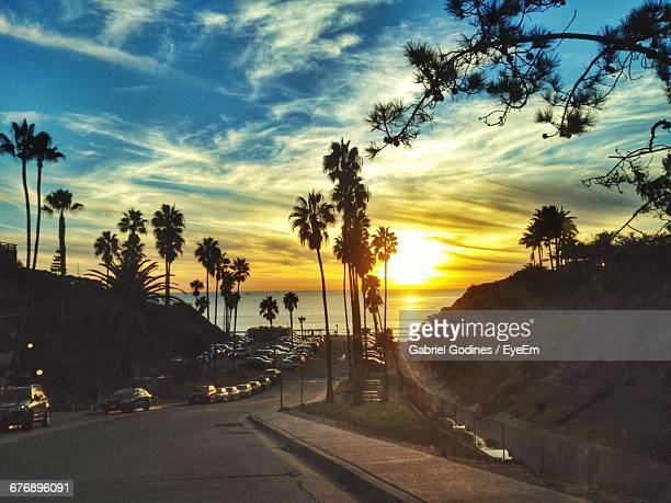 cars on street against sky during sunset - san diego - fotografias e filmes do acervo