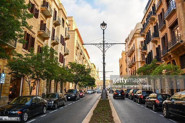 cars on street amidst buildings in city - beirut stock pictures, royalty-free photos & images
