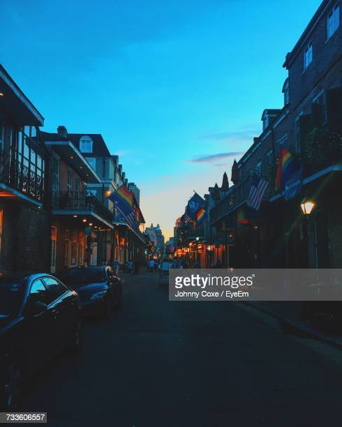 cars on street in city against clear sky - new orleans stock photos and pictures