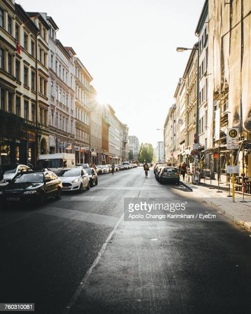 cars on street in city against clear sky - berlin stock pictures, royalty-free photos & images