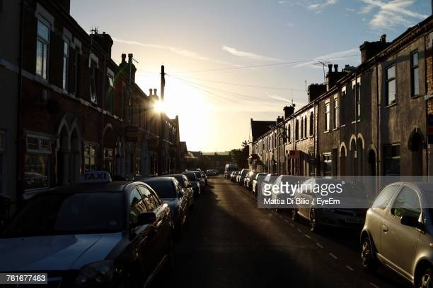 cars on street in city against sky during sunset - stoke on trent stock photos and pictures