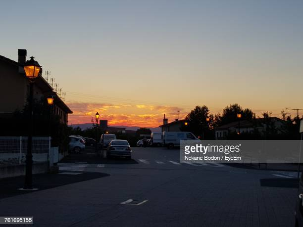 cars on street in city against sky during sunset - nekane stock photos and pictures