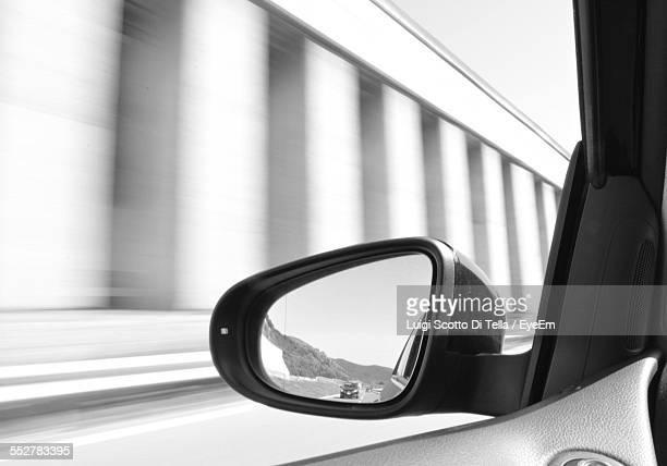 Cars On Street Seen Through Side-View Mirror