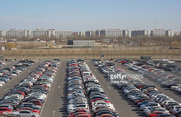 Cars on the parking lot of Beijing International Airport China's passenger car sales rose 99% in 2014 a solid result but a marked slowdown from 2013