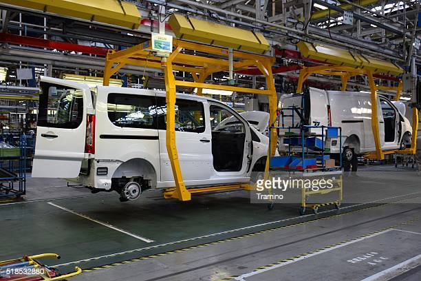 cars on the production line - vehicle brand names stock photos and pictures