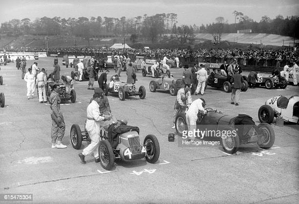 Cars on the starting grid for the JCC International Trophy, Brooklands, 2 May 1936. MG R 746S cc. Event Entry No: 44. Centre Riley 1089 cc. Event...