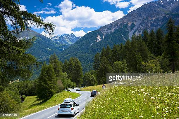 Cars on touring holiday in the Swiss Alps Swiss National Park Switzerland