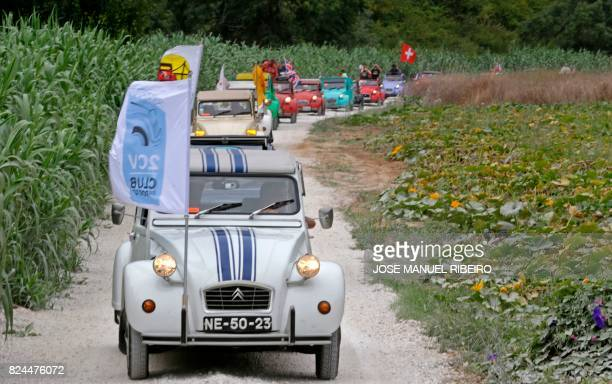 Cars parade through the country side between Ericeira and Mafra during the World 2017 2CV Meeting July 30, 2017. - The event is held between the 26th...