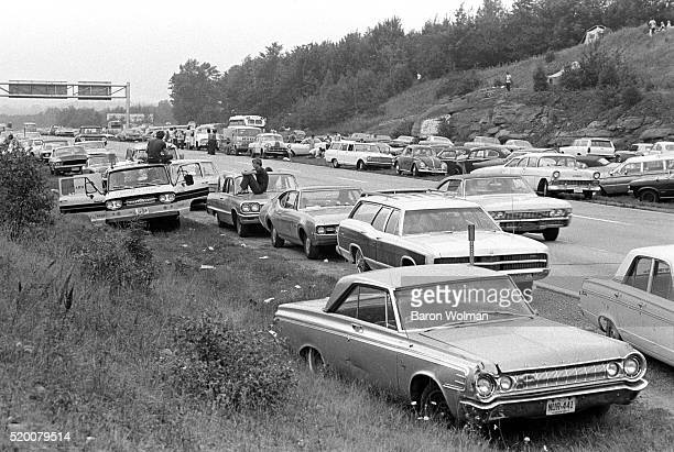 Cars park in hard shoulder at the the Woodstock Music Art Fair Bethel NY August 15 1969