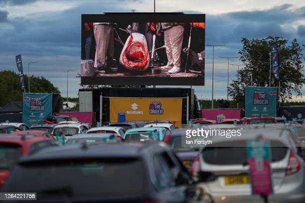 Cars park up to watch a showing of Jaws during a drivein cinema experience at Newcastle Airport on August 05 2020 in Newcastle upon Tyne England The...