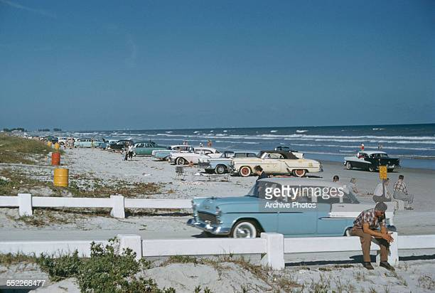 Cars parked along the shore at Cocoa Beach Florida USA December 1958