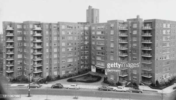 Cars parked along the sidewalk in front of the nine-storey Park Briar development at 110-45 Queens Boulevard in the Forest Hills neighbourhood of...