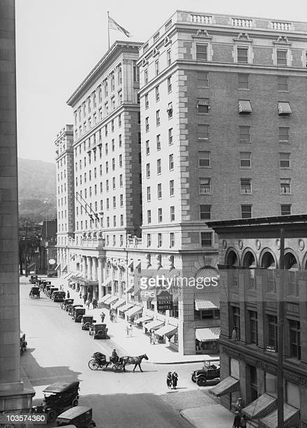 Cars Parked Along The Street And A Horsedrawn Carriage Outside Mount Royal Hotel In Montreal