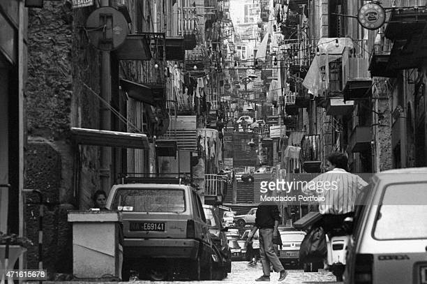 'Cars parked and hanged out washing marking a lane of the Spanish Quarters Naples 1980s '