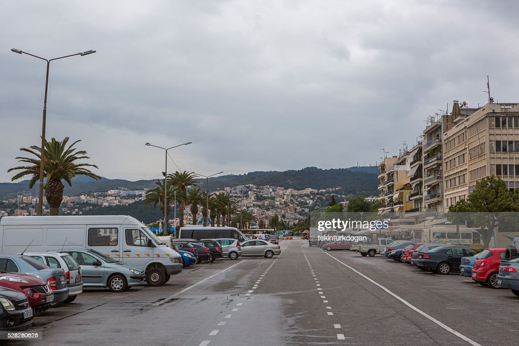 cars parked at harbour of kavala summer town in greece : Stock Photo