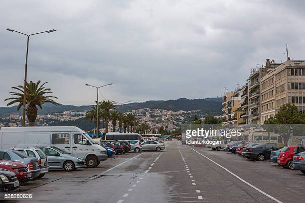 cars parked at harbour of kavala summer town in greece
