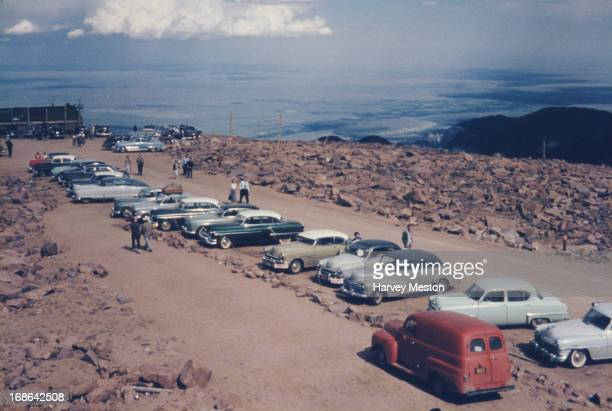 Cars parked at the summit of Pike's Peak Mountain El Paso County Colorado circa 1962 Pike's Peak is one of Colorado's 54 mountains that rise more...