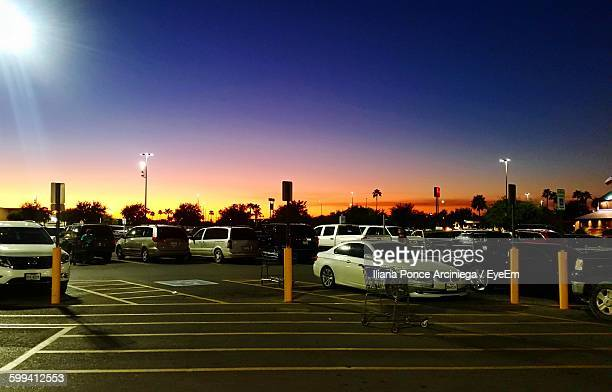cars parked by street against sky during sunset - mcallen texas stock pictures, royalty-free photos & images