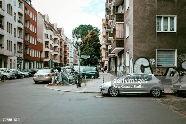 Cars Parked By Street Amidst Buildings