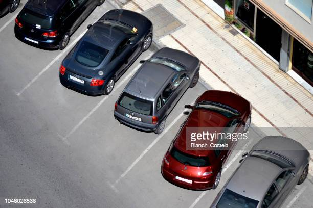 Cars parked diagonally viewed from above