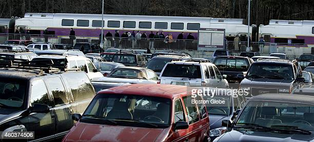 Cars parked haphazardly at the Abington MBTA commuter rail station and parking lot