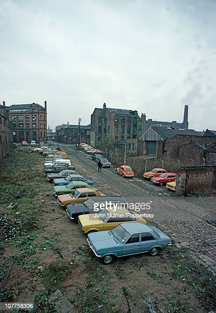 Cars parked in a car park on cleared waste ground in Manchester England in 1976