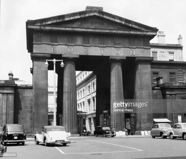Cars parked in front of the doric arch at Euston station, London which is to be pulled down when the main line and underground station is rebuilt.