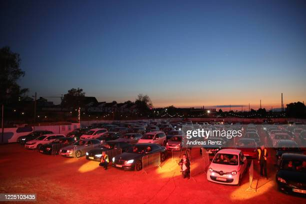 Cars parked in line and follow German singer Heino's performance during the first BonnLive drivein concert at Am Westwerk during the Coronavirus...