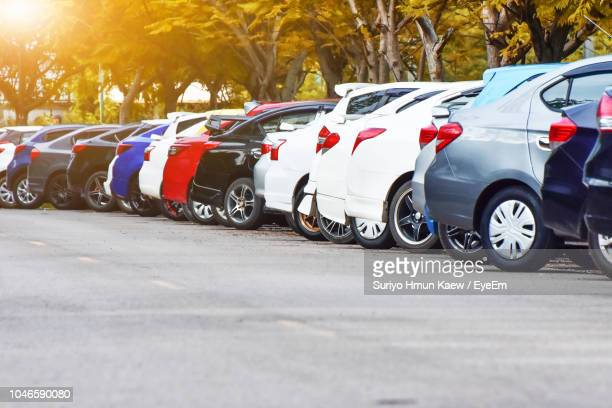 cars parked in row on road - car park stock pictures, royalty-free photos & images