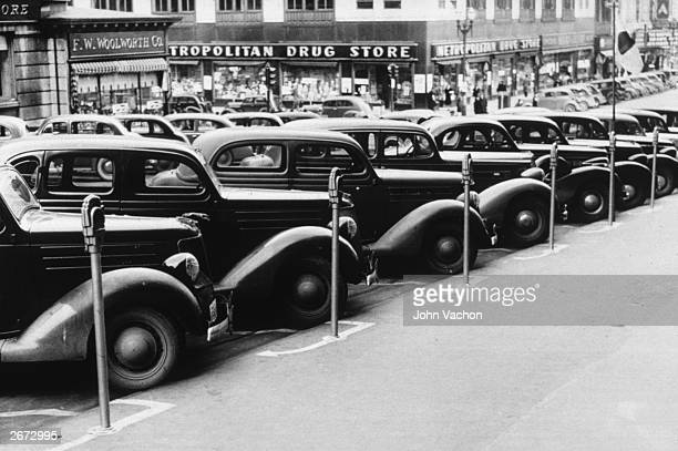Cars parked in the street in Omaha Nebraska Coin operated parking meters determine the time available