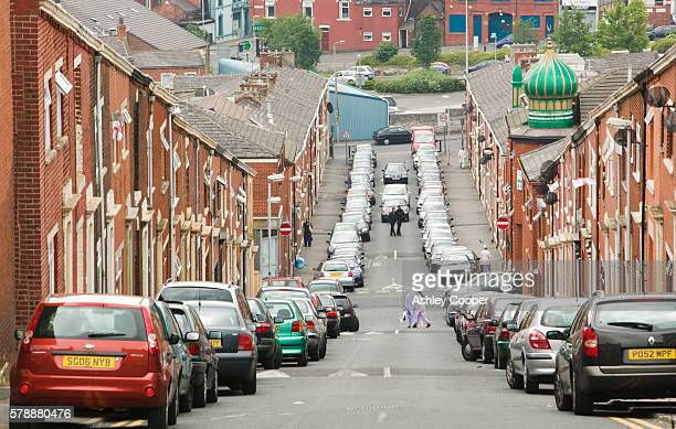 Cars parked on a street in the Asian area of Blackburn UK