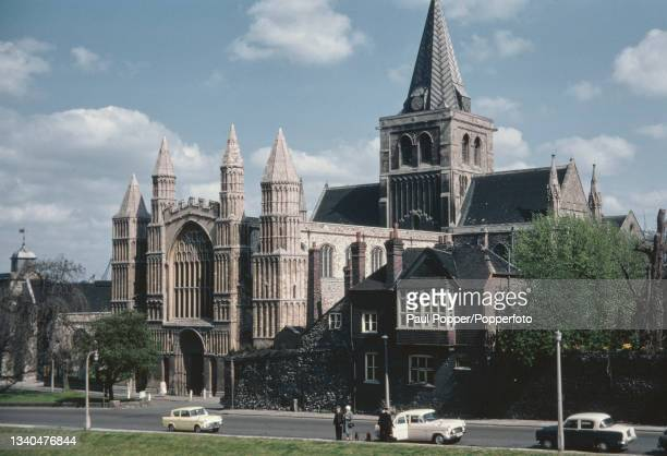 Cars parked on Boley Hill in front of the west entrance to Rochester Cathedral in the city of Rochester, Kent in May 1969.