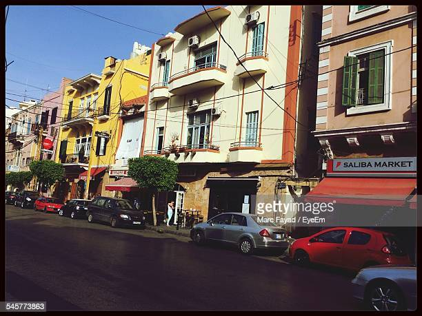 cars parked on road along buildings - beirut stock pictures, royalty-free photos & images