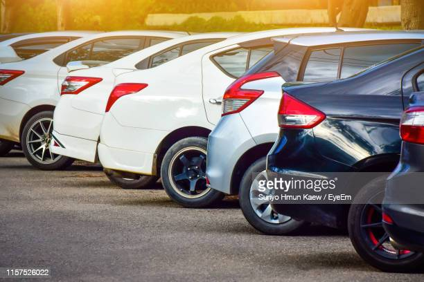 cars parked on road - stationary stock pictures, royalty-free photos & images