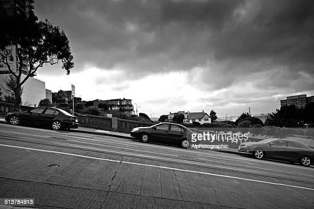 Cars parked on steep street