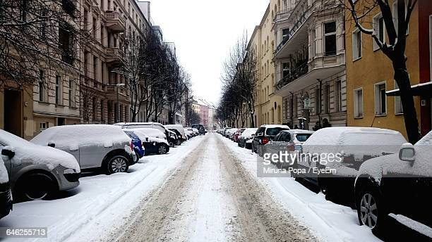 Cars Parked On Street In City During Winter