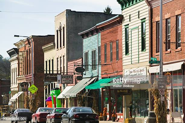 cars parked on street - small town america stock pictures, royalty-free photos & images