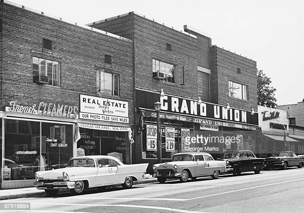 cars parked on town main street, (b&w) - 20th century stock pictures, royalty-free photos & images