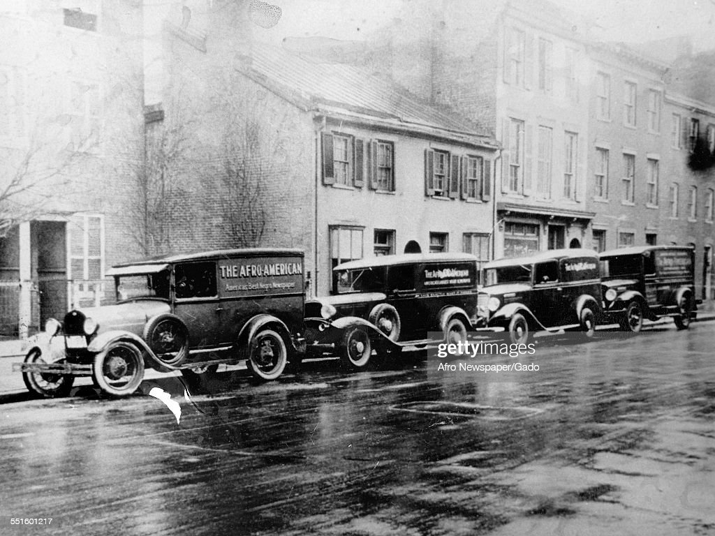 Cars parked outside the offices of the Afro American newspaper founded in the 19th century, Baltimore, Maryland, 1948.