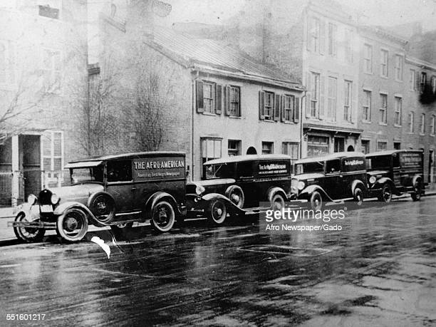 Cars parked outside the offices of the Afro American newspaper founded in the 19th century Baltimore Maryland 1948