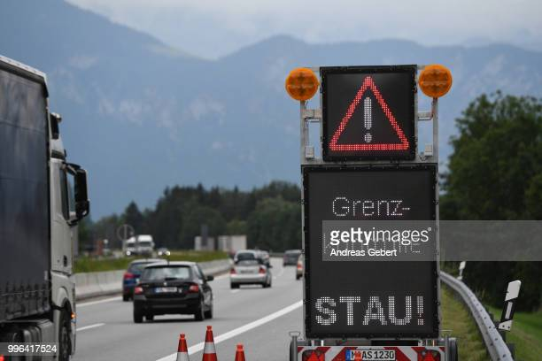 Cars pass a sign reading Grenzkontrolle some kilometers before the border between Germany and Austria prior to the European Union member states'...