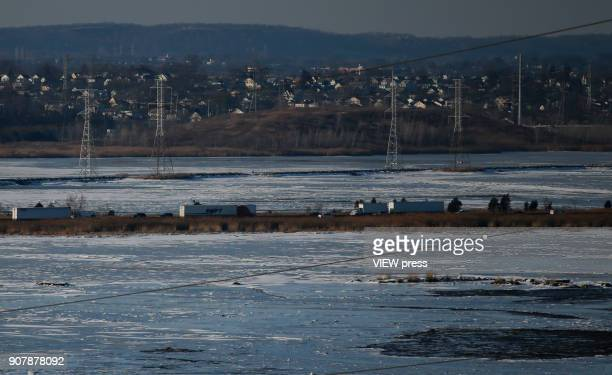 Cars pass by a freeway as frozen waters are seen on January 18 2018 from Newark New Jersey NASA researchers said that 2017 was the secondwarmest year...