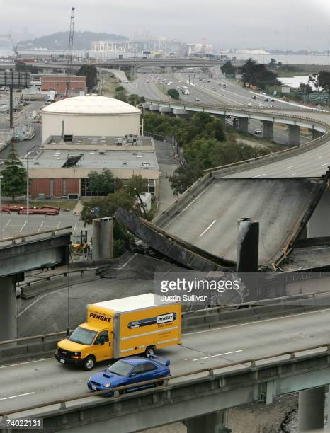 Cars pass by a section of California Interstate 580 after it collapsed from the heat of a tanker truck explosion April 29 2007 in Emeryville...