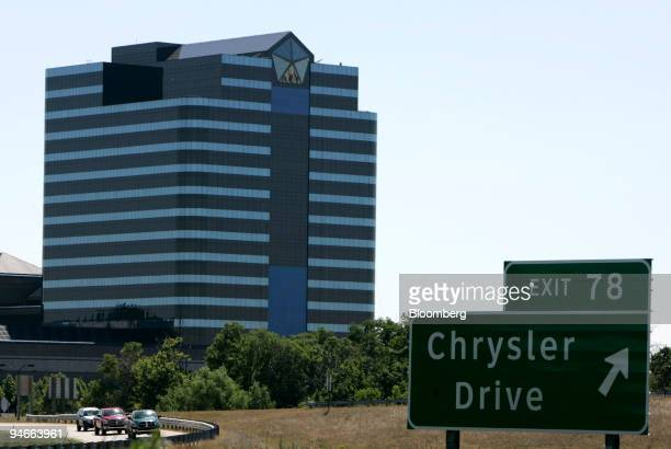 Cars pass by DaimlerChrysler AG's U.S. Headquarters in Auburn Hills, Michigan, Friday, Aug. 3, 2007. DaimlerChrysler AG completed the sale of an 80.1...