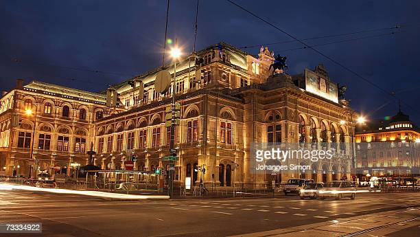 Cars pass the illuminated Vienna Opera house on February 15 Vienna Austria The Vienna Opera Ball will take place there this evening