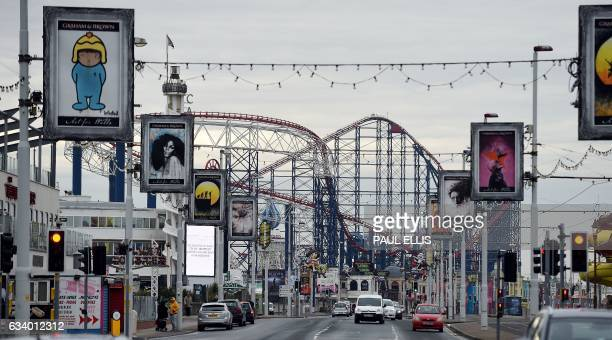 Cars pass the Pleasure Beach in Blackpool north west England on February 6 2017 Blackpool is a seaside resort in the northwest coast of England / AFP...
