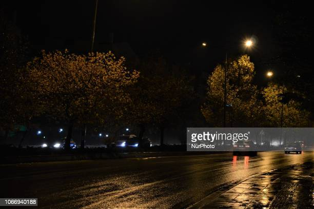 Cars pass through a raindrenched road during a heavy rainfall in Ankara Turkey on November 30 2018 Torrential rainfalls continue across Turkey for...