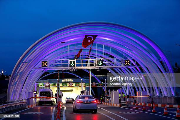 Cars pass through the Eurasia tunnel after it's opening in Istanbul Turkey on December 22 2016 Traffic began to flow from both Europe and Asia sides...