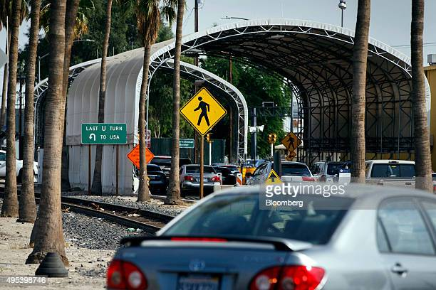 Cars pass through the US Border Inspection Station crossing in Calexico California US on Monday Oct 12 2015 Among Rabobank's 119 branches in...