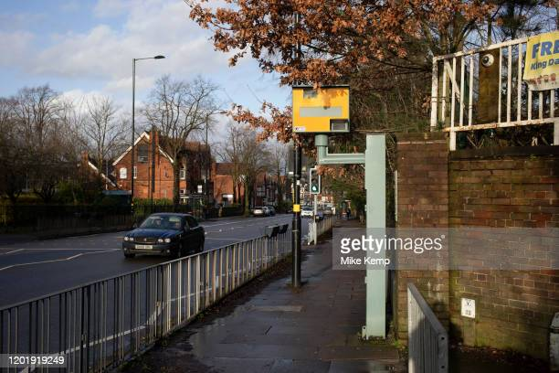 Cars passing a yellow speed camera in Wake Green on 16th Febuary 2020 in Birmingham United Kingdom A traffic enforcement camera is a camera which may...